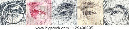 Portraits / images / the eyes of famous leader on banknotes currencies of the most dominant countries in the world i.e. Japanese yen US dollar Chinese yuan Australian dollar. Financial concept.