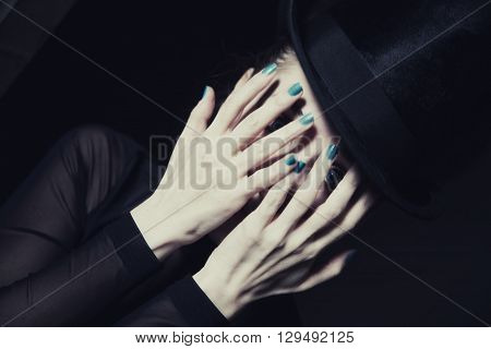 Woman Covering Face With Her Hands