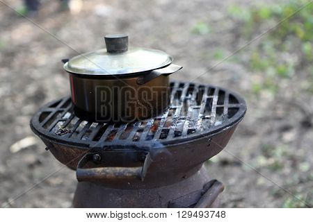 Saucepan With Water On A Grill