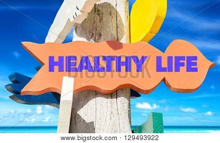 Healthy Life signpost with beach background