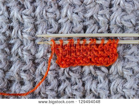 Knitting wool and knitting needles on a crochet rustic background