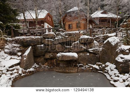 wooden house in a winter wonderland village