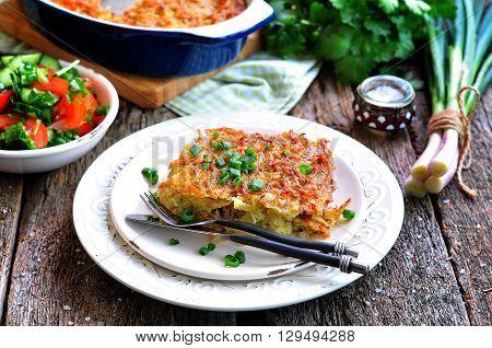 Potato - Kugel Casserole. Jewish cuisine. wooden table