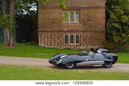 Saffron Walden, Essex, England - April 24, 2016: Classic Black Lotus racing car in front of old building.