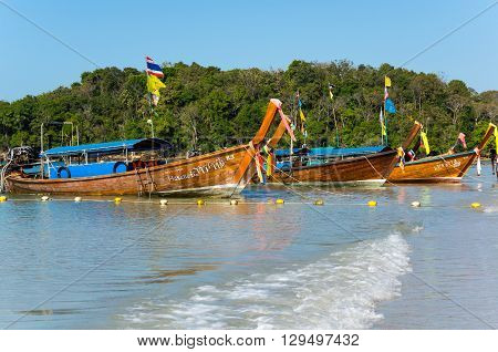 CRABI PROVINCE THAILAND - FEBRUARY 04 2015: Traditional thai long tail boats waiting for tourists to travel to beautiful islands in Thailand