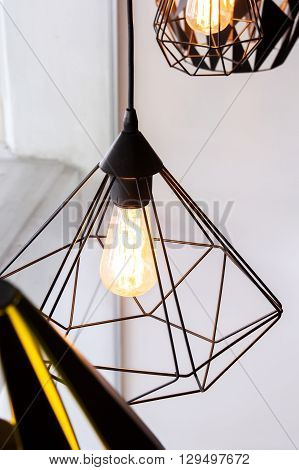 Edison's light bulb and lamp in modern style coffee shop. warm tone photo