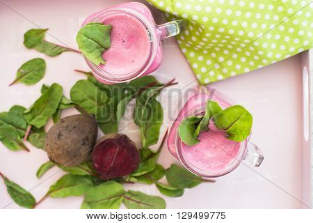 Glass of fresh beetroot juice with bets and leafs . Beetroot smoothie in jar. Pink detox. Eye bird view. Top view.