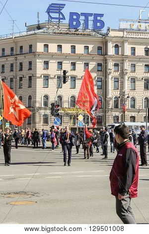 St. Petersburg, Russia - 1 May, Two standard-bearer with flags, 1 May, 2016. Day festive demonstration on the Nevsky Prospect in St. Petersburg, the first of May.