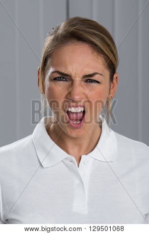 Portrait Photo Of Angry Young Woman Screaming
