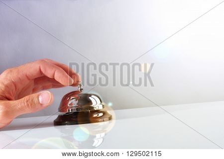 Customer Ringing The Bell Hotel Service Front View