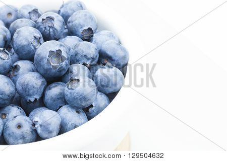 Freshly Picked Blueberries In White Bowl - Close Up Studio Shot With Focus On Berries