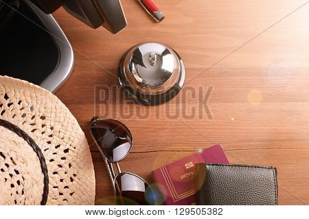 Tourist Objects On Wood Table Of Hotel Reception