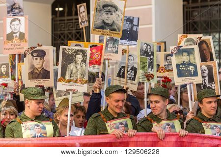 St.PETERSBURG, RUSSIA - MAY 9, 2016: Participants of Immortal Regiment - public action, during which participants carried portraits of their relatives who participated in Great Patriotic War.