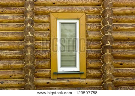 Wall Log House With A Beautiful Texture Treated