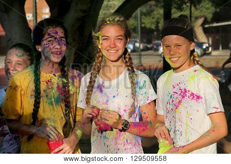 Rustenburg Marathon Club Rainbow Run - NOVEMBER 25: Lovely teen girl participants covered in powder paint posing for picture on November 25 2015 Rustenburg South Africa.