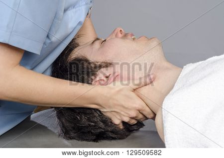 Physiotherapist Is Doing Manipulation Cervical To A Man Patient