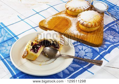 Sweet pie on the cutting board. Jam pie. Small pie. Pie. Sweet dessert . Sweet pastry.