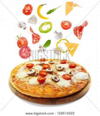 Tasty pizza decorated with falling ingredients isolated on white background