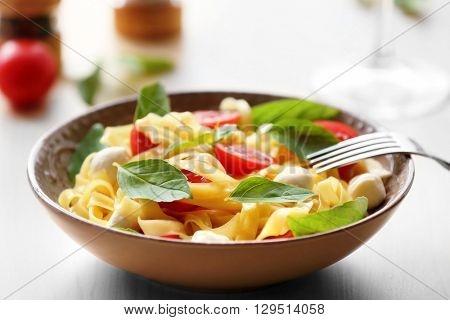 Delicious cold pasta salad in bowl on the table closeup
