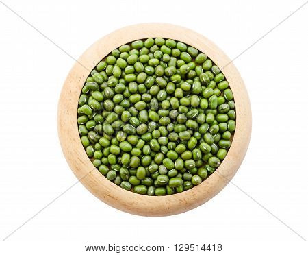 Green mung beans seeds in wooden dish isolated on white background Save clipping path.