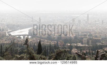 Panorama of Verona (Italy) in the fog. The city of Romeo and Juliet in a foggy winter day.