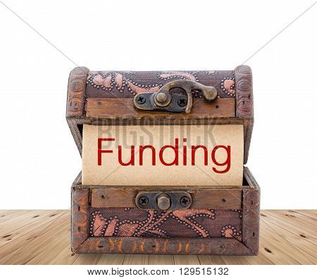 Funding word on paper in treasure chest. Business concept.