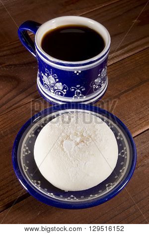 Traditional Japanese mochi in a blue platter on a wooden table