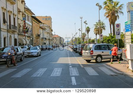 Viareggio Italy - June 28 2015: People on a pedestrian crossing. Province Lucca Tuscany region of Italy