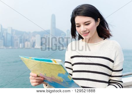 Woman seeking the location of the landmark in Hong Kong