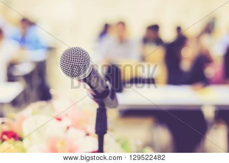 Microphone On The Desk In Meeting Room With Blur People Background