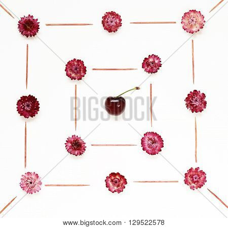 Colourful bright pattern made of flowers and burgundy cherries