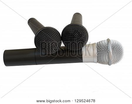 Isolated image of three microphones. The big one with a white metal head and two smaller ones with black metal heads.