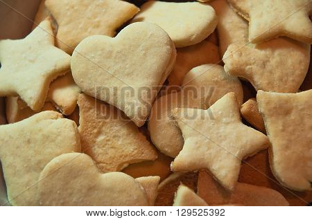 Homemade cookies photographed in closeup.Cookie looks like hearts stars and other shapes.