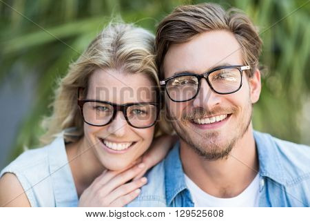 Portrait of happy young couple in spectacles