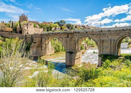 TOLEDO,SPAIN - APRIL 23,2016 - Bridge San Martin over river Tajo in Toledo. Toledo is a municipality located in central Spain.