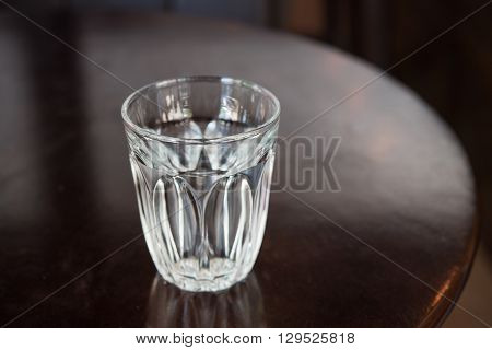 water glass on wood table in coffee shop