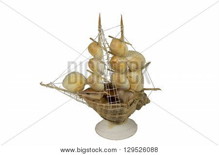 Sailboat made of shells as souvenir on white background.