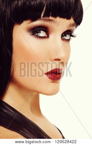 Portrait of young beautiful brunette with smokey eye make-up, copy space