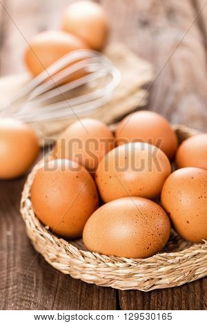 fresh brown chicken eggs on wooden table