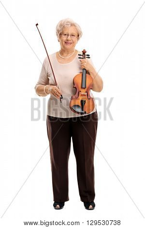 Full length vertical shot of a mature woman holding an acoustic violin isolated on white background
