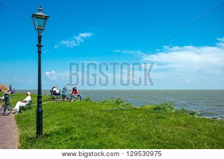 Volendam Holland - July 24 2014: Waterland district people on the seafront