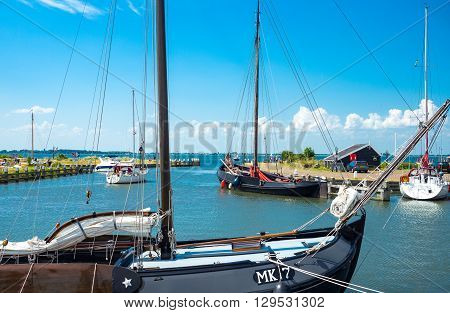 Marken Holland - July 24 2014: Waterland district boats in the little harbour of the village