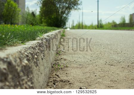 kerb line or curb stone border on the asphalt old town road