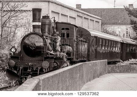 Veteran train in a curve in sepia colors