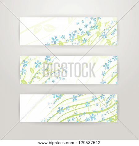 Horizontal banners with blue flowers, branch and leaves