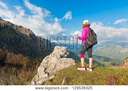 Girl Hiker Rests In The Mountains
