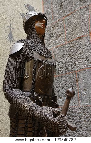 PONTGIBAUD FRANCE May 6 2016 : A knight in armour in Chateau-Dauphin medieval castle. The castle owes its name to the coat of arms of the Count of Auvergne who built it in the 12th century