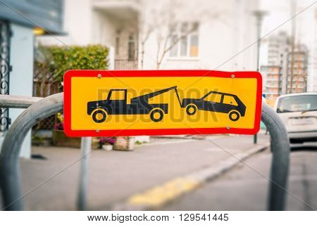 Street Sign Of A Car Being Removed