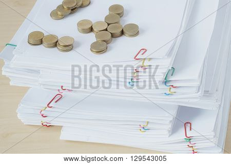 Pile Of Gold Coins On Pile Of Overload Paperwork