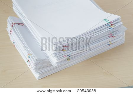 Pile Of Overload Paper And Reports With Colorful Paper Clip